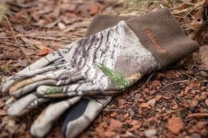 camouflage manzella hunting gloves in woods